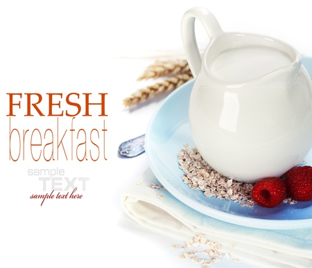 milk jugs: Oat flakes, milk and berries over white (with sample text)  Stock Photo