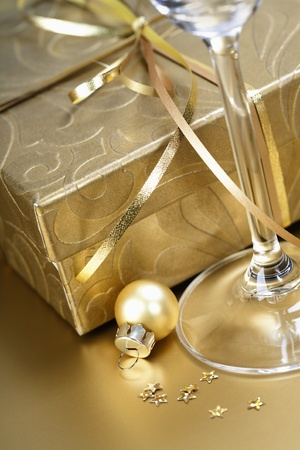 Golden gift box with golden ribbon and champagne photo