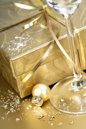 Golden gift box with golden ribbon and champagne Stock Photo - 11263116