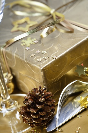 Golden gift box and christmas place setting photo
