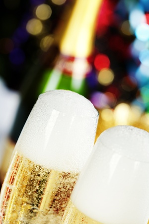 Champagne on Christmas tree background photo