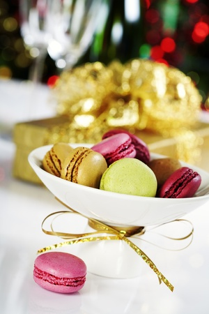 Colorful macaroons on Christmass tree background photo