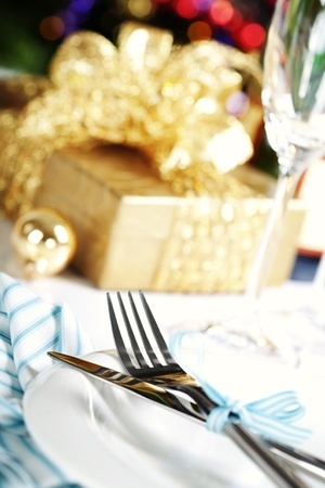 place setting on Christmas tree background Stock Photo - 11600824