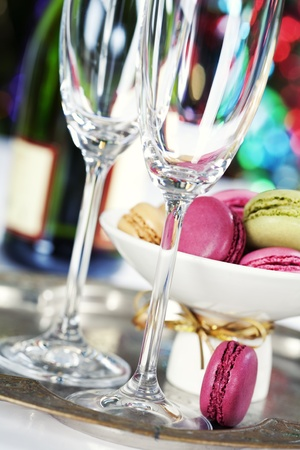 Colorful macaroons and Champagne on Christmass tree background Stock Photo - 11600827