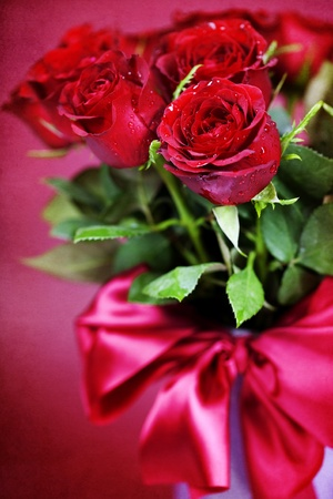 bouquet of red roses in vase photo