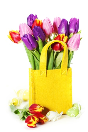 festal: spring tulips with easter eggs  on white background Stock Photo