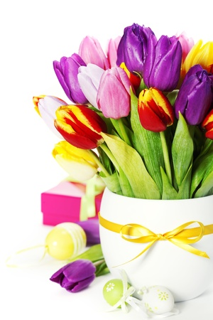 spring tulips with easter eggs  on white background photo
