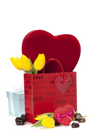 gift boxes, chocolate  and flowers for Valentine's day ( on white background). Stock Photo - 12235058