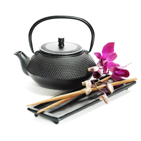 natural setting: Asian food concept (Tea pot, orchid and chopsticks)