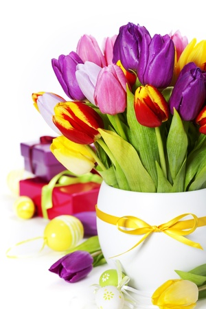 spring tulips with easter eggs  and gift boxes on white background photo