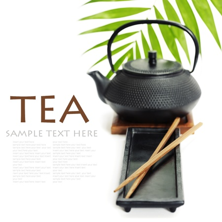 Asian food concept (Tea pot and chopsticks) with sample text photo