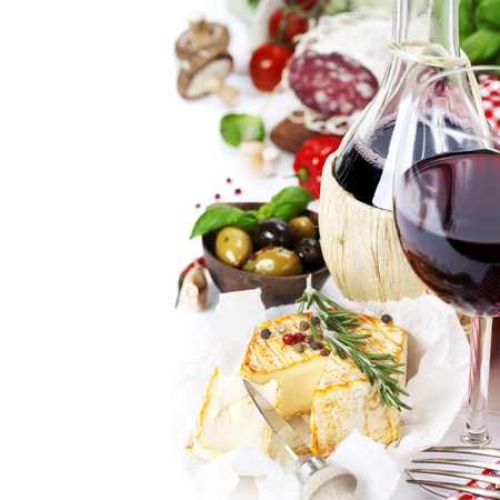 recipe background: Italian food  (cheese, salami, tomatoe, garlic, pepper, mushroom, olives, olive oil, basil)  and wine over white
