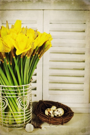 easter composition with eggs and spring flowers photo