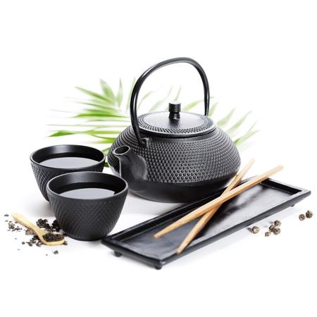 Asian food concept (Tea pot and chopsticks)
