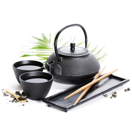 Asian food concept (Tea pot and chopsticks) photo