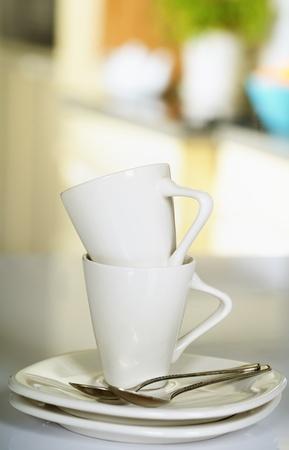 microondas: Tazas de café cerca disparar en la cocina