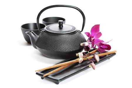 Asian food concept (Green tea, orchid and chopsticks) photo