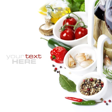 Fresh herbs and spices (tomatoe, garlic, pepper, mushroom, bay leaves, olive oil) With wine over white (with easy removable sample text) Stock Photo - 13111116