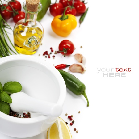Ceramic Mortar with Pestle, fresh spices and vegetables (with easy removable sample text)   photo