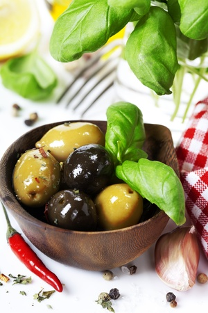 Olives  with basil and ingredients over white Stock Photo - 13324201