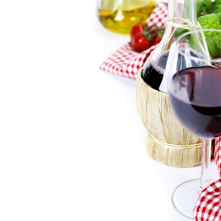 italy culture: Basket bottle of wine from Italy and fresh ingredients over white