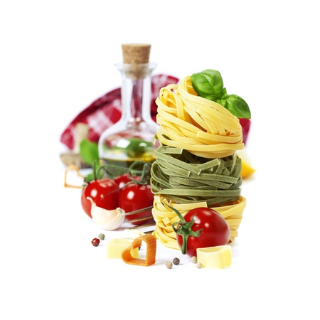 ribbon pasta: Italian Pasta with tomatoes,  olive oil and basil on a white background Stock Photo