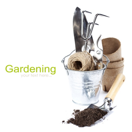 sheds: garden tools (shovel,  rake, pruner, garden string and peat pots ) over white (with easy removable text)