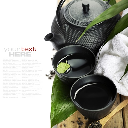 brewed: asian tea set and spa settings on wooden board - with sample text Stock Photo
