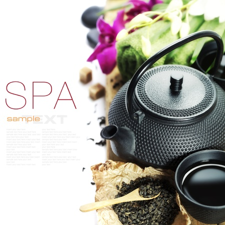 traditional wellness: asian tea set and spa settings on wooden board - with sample text Stock Photo