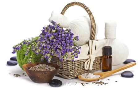 lavender spa  fresh lavender flowers in a basket,  essential oil, salt,  Herbal massage balls, zen stones  over white Stock Photo