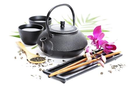 Asian Food-Konzept (Grüner Tee, Orchidee und Stäbchen)