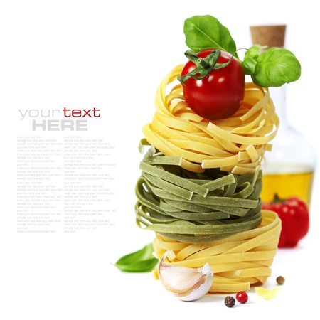 Italian Pasta with tomatoes,  olive oil and basil on a white background (with easy removable sample text)   Stock Photo
