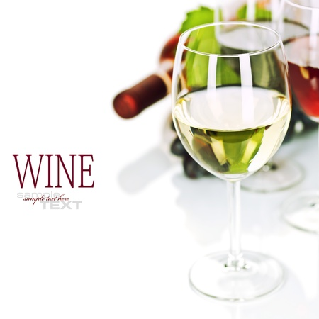 removable: Glasses of white, red and rose wine and grapes over white  (easy removable sample text)