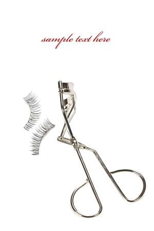 hair curler: Macro of eyelash curler and false eyelashes isolated on white