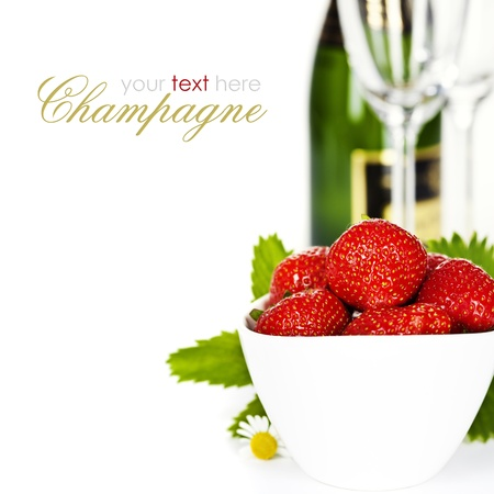 Romantic still life with champagne and fresh  strawberry over white (with easy removable text) photo