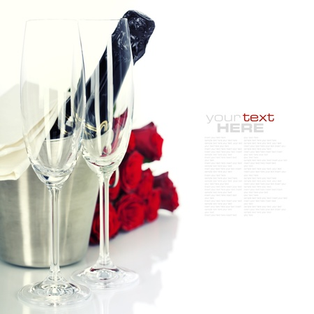 removable: Romantic still life with champagne and beautiful red roses over white (with easy removable text) Stock Photo