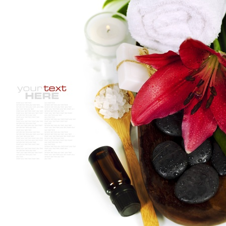 Spa concept (flowers, towel, essential oil, sea salt and massage stones) (with easy removable sample text) photo