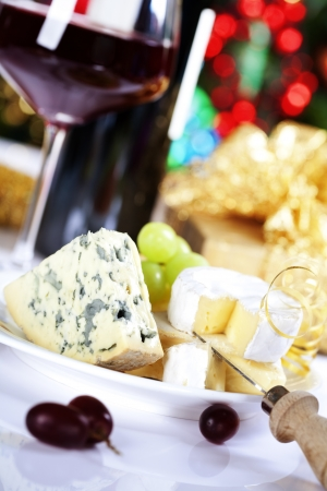 Cheese and wine on Christmass tree background Stock Photo - 15053976