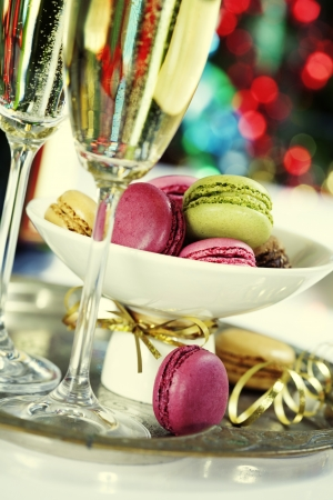 macaroon: Colorful macaroons and Champagne on Christmass tree background Stock Photo