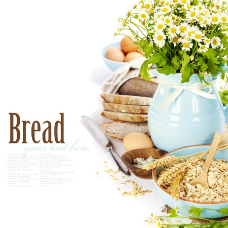 wooden insert: fresh chamomile flowers and bread over white  (with easy removable text) Stock Photo