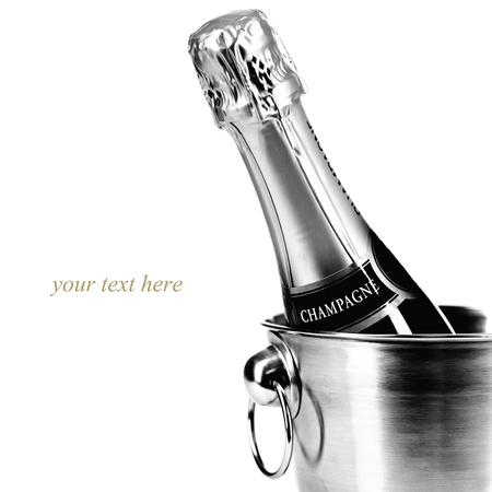 champagne bottle: Bottle of champagne in cooler over white (with easy removable sample text)
