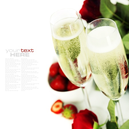 Romantic still life with champagne, strawberry and beautiful red roses over white (with easy removable text) Stock Photo