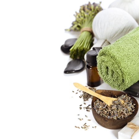 lavender spa (fresh lavender flowers,  essential oil, zen stones,  Herbal massage balls, towel) over white photo