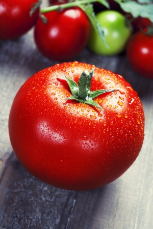 fresh taste: Fresh tomatoes on a wooden table top