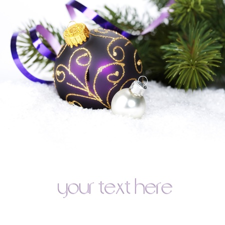 Christmas ball decoration with snow  and branch of Christmas tree (with sample text) photo