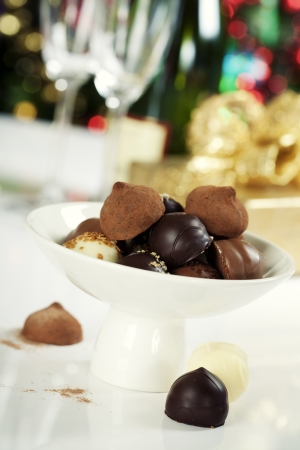Delicious chocolate pralines and truffles on Christmass tree background Stock Photo - 15380097