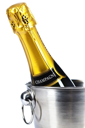 Bottle of champagne in cooler over white Stock Photo - 15380129