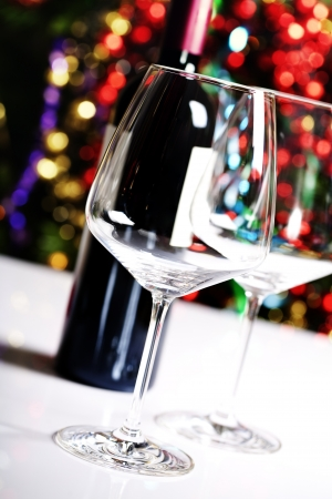 Wine glasses on Christmas tree background photo