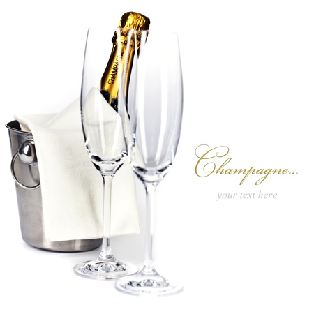 champagne bottle: Champagne bottle in cooler and two champagne glasses (with easy removable sample text)