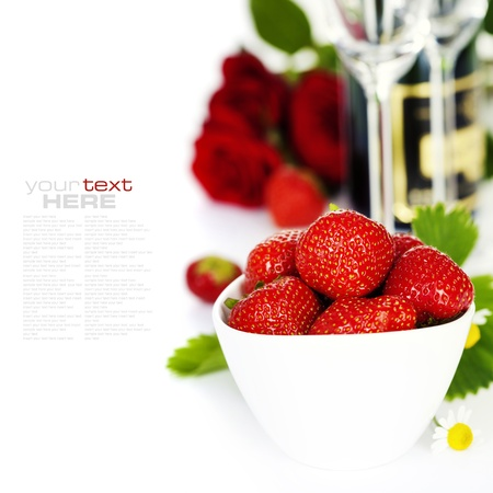 text room: Romantic still life with champagne, strawberry and beautiful red roses over white (with easy removable text) Stock Photo